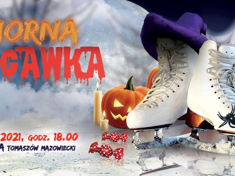 Na zdjęciu baner imprezy halloweenowej Upiorna Ślizgawka na Arenie Lodowej. Na banerze łyżwy i halloweenowe rekwizyty - dynia, świece