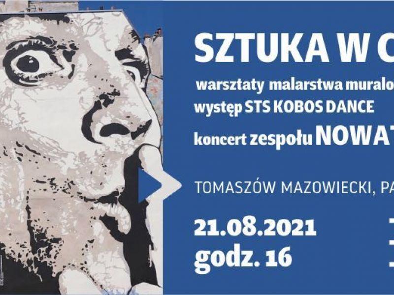 Na zdjęciu baner Sztuki w centrum, na banerze mural na boku kamienicy przedstawiający twarz człowieka